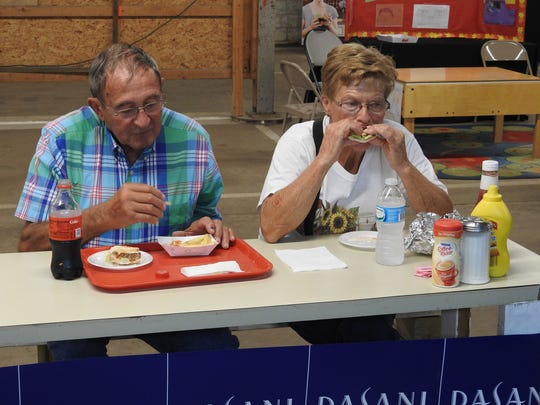 Nelson and Linda Hall eat from Ron's Coke Stand at