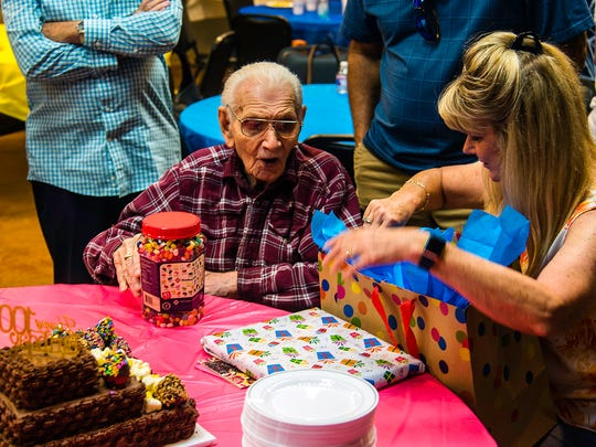 Bill Fichte gets a little help unwrapping presents at his 100th birthday at San Angelo First Assembly of God Church  July 15, 2017.