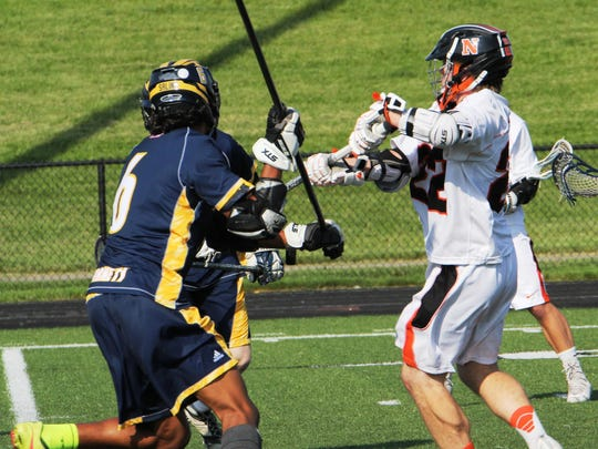 Northville's Connor Sweeney (right) had four goals and one assist against Saline.