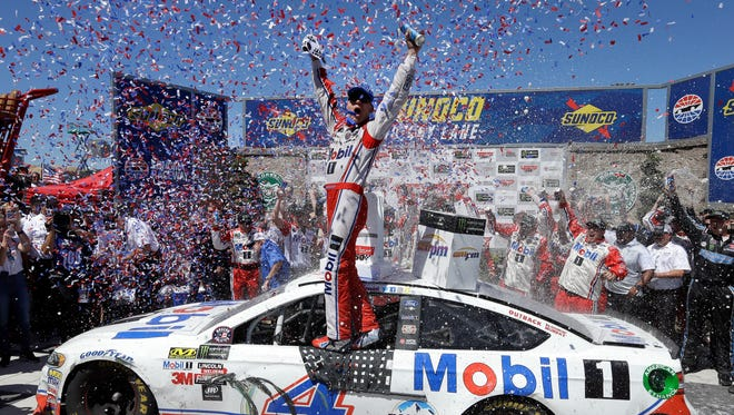 Kevin Harvick celebrates after winning the NASCAR Monster Energy Cup Series race Sunday.
