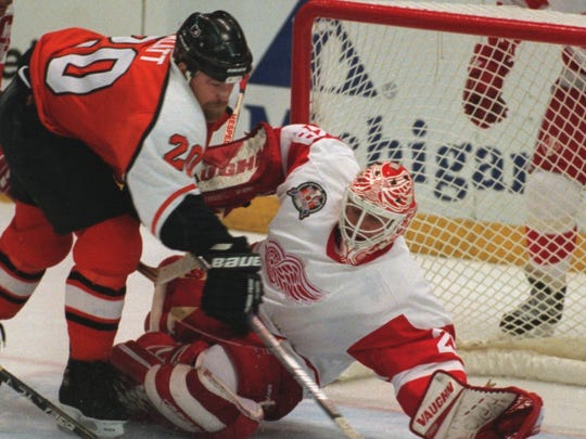 Mike Vernon makes a save against the Flyers' Trent