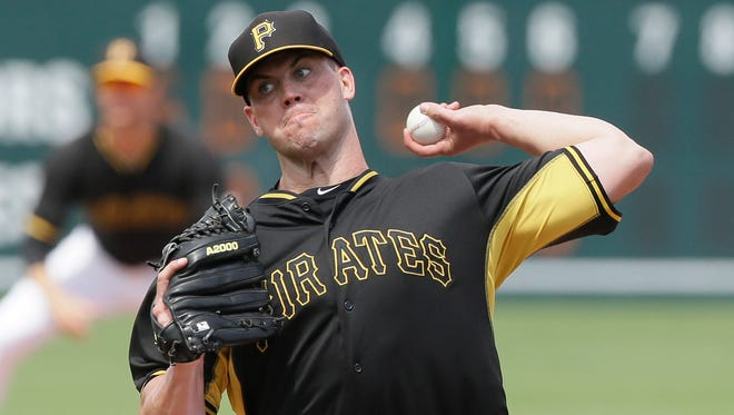 Pittsburgh Pirates' pitcher Clayton Richard throws during the seventh inning of a spring training exhibition baseball game against the Atlanta Braves in Bradenton, Fla., Thursday, March 26, 2015.