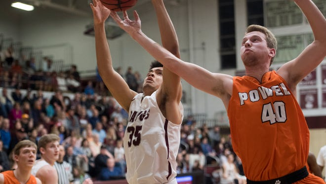 Powell's Westin Reynolds and Bearden's Shamarcus Brown go after the rebound in the Region 2-AAA boys basketball final on Thursday.