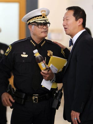 Cincinnati Police Chief Jeffrey Blackwell talks with Santa Ono, president of the University of Cincinnati, at City Hall before a press conference at which the shooting death of Samuel Dubose by a UC Police officer during a traffic stop was discussed.