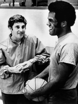 Bobby Knight and Scott May share a laugh.