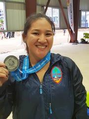 Guam weightlifter Jacinta Sumagaysay displays the silver