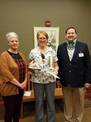 Theresa Hecker, CNA, was chosen for the Service Excellence Star Award for the month of December at Felician Village. Pictured from left: Kristin Korff, Next Step nurse manager; Theresa Hecker, CNA, Service Excellence Award winner; and Frank Soltys, Felician Village president and CEO.