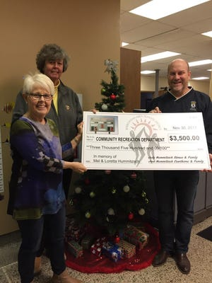 Jane Cawthorne and Judy Straus present their donation to Community Recreation  Department Director John Koehler, in memory of Mel & Loretta Hummitzsch and their brother Jerry Hummitzsch.