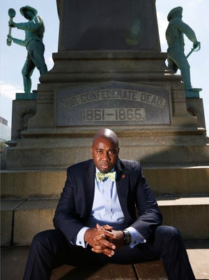 Ricky Jones, University of Louisville professor of Pan-African Studies sits at the base of the confederate statue on the campus of the University.  Professor Jones and others would like to see it removed. April 20, 2016.
