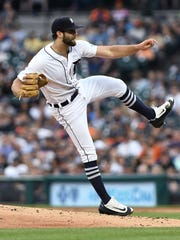 Tigers starting pitcher Daniel Norris watches a pitch