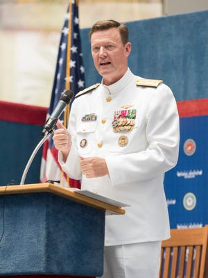 Rear Adm. Kyle J. Cozad, the new commander of the Naval Education and Training Command, speaks on Thursday, July 20, 2017, during a change of command ceremony at the National Naval Aviation Museum in Pensacola.