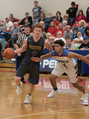Unioto's Logan Swackhammer handles the basketball while being guarded by Zane Trace's Cam Evans during last Friday's contest in Kinnikinnick. Swackhammer is averaging 16.3 points, four rebounds and five assists per game.