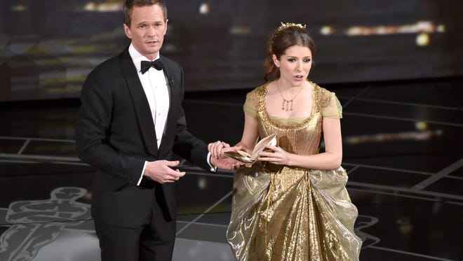 Host Neil Patrick Harris, left, and Anna Kendrick perform at the Oscars on Sunday, Feb. 22, 2015, at the Dolby Theatre in Los Angeles.