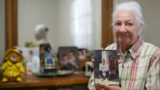 Never allowed to have a child of her own, Shirley Rankin, 76, of Waynesboro surrounds herself with photos of family members with their children. Rankin was sent to the Lynchburg Training School and Hospital when she was a teenager, where she was sterilized along with thousands of other people in the state of Virginia as a part of the eugenics movement.