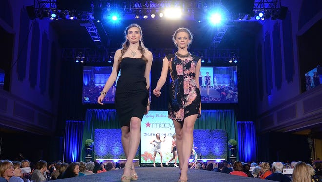 Models Emme Metry and Mackenzie Nevill walk the runway at the KDF Fashion Show at Horseshoe Casino on March 26, 2015.