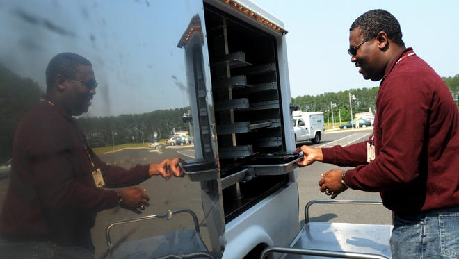 Edward Taylor with Shore Up loads food into a Meals on Wheels truck at MAC Inc. in Salisbury.