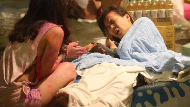 Injured victims are treated after an accidental explosion during a music concert at the Formosa Water Park in New Taipei City, Taiwan. The New Taipei City fire department says 200 people were injured in an accidental explosion of colored theatrical powder Saturday night near a performance stage where about 1,000 people were gathered for party.