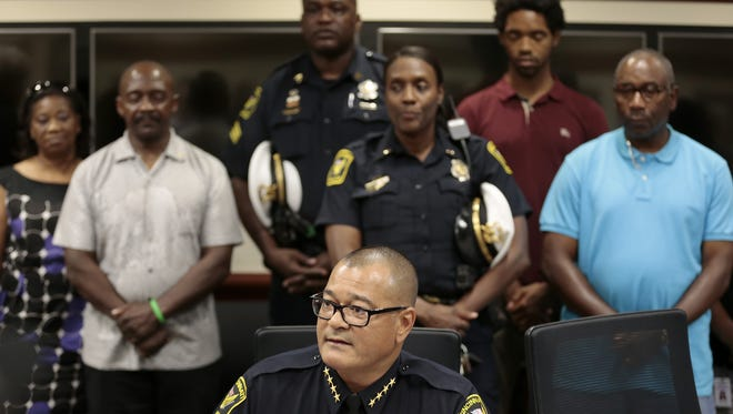Supporters stand by Cincinnati Police Chief Jeffrey Blackwell as he speaks to the media in a late-night press conference at Cincinnati Police District 1 headquarters in Cincinnati, Ohio, on  Wednesday, Sept. 2, 2015. Blackwell addressed an expected vote of no confidence from the police union.