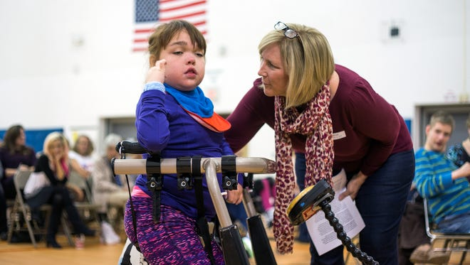 Kate Biondi, right, and her daughter Olivia, 13, who is a MOVE student at Broome Tioga BOCES, share a moment during Friday's ceremony.