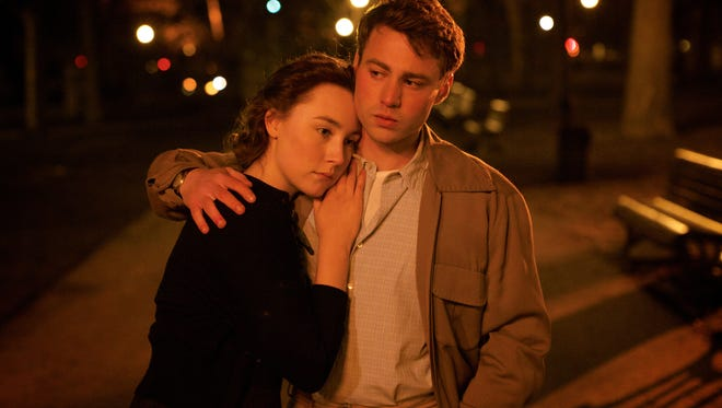 """Saoirse Ronan, left, and Emory Cohen in a scene from the film """"Brooklyn."""""""