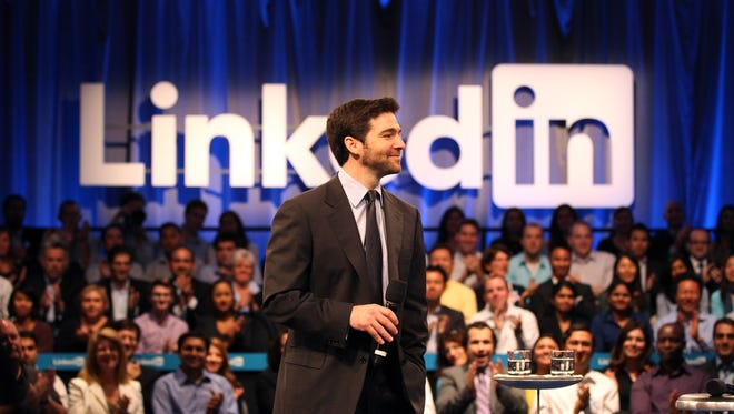Linkedin CEO Jeff Weiner speaks to the audience prior to a town hall meeting with U.S. President Barack Obama.