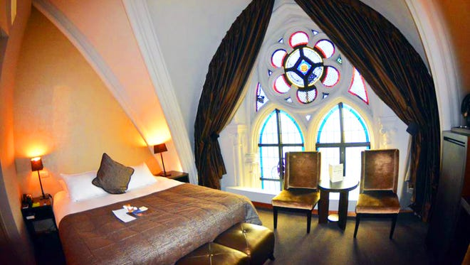 Inside Martin's Patershof hotel in Mechelen, Belgium, stained glass windows from the original monastery and architectural details that used to be too high to appreciate are part of the guest rooms.