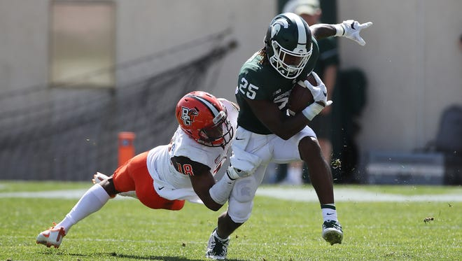 Darrell Stewart Jr. of the Michigan State Spartans tries to escape the tackle of Cameron Jefferies of the Bowling Green Falcons during the first half at Spartan Stadium on September 2, 2017 in East Lansing, Michigan
