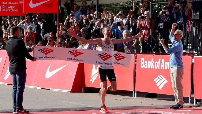 Galen Rupp of the United States wins the men's race with a time of 2:09:20 during the Bank of America Chicago Marathon on Oct. 8.