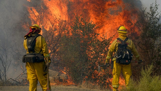 CalFire firefighters protect structures from fires in Sonoma on Saturday.