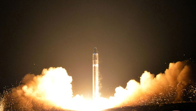 FILE - This Wednesday, Nov. 29, 2017, file image provided by the North Korean government on Thursday, Nov. 30, 2017, shows what the North Korean government calls the Hwasong-15 intercontinental ballistic missile, at an undisclosed location in North Korea. Cathay Pacific said in a statement Monday, Dec. 4, the crew on a San Francisco-to-Hong Kong flight reported witnessing the apparent re-entry of the ICBM that North Korea launched before dawn Wednesday. Independent journalists were not given access to cover the event depicted in this image distributed by the North Korean government. The content of this image is as provided and cannot be independently verified.