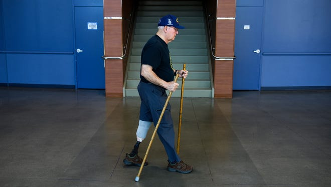 Joseph Cole, 76, walks a lap around the Bon Secours Wellness Arena on Jan. 2, 2018. Cole, who had his leg amputated two years ago as a result of diabetes, is training for a 5k in Florida.