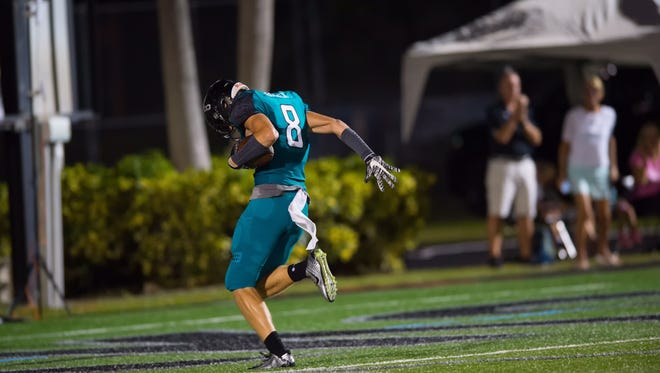 Gulf Coast's Luke Baker scores a touchdown during a game last year. Baker caught 11 passes for 196 yards and two scores for the Sharks as a junior. He committed to Southern Mississippi this week.