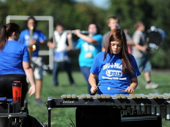 Emilee Ross, 17, plays the xylophone during a Maysville High School marching band practice in preparation for the Buckeye Invitational hosted Saturday at Ohio State University's Ohio Stadium.