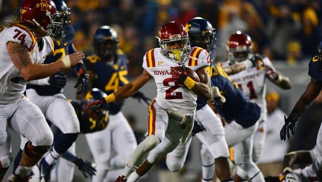 Iowa State Cyclones running back Aaron Wimberly (2) runs with the ball during the second quarter  of the game against the West Virginia Mountaineers in 2013.