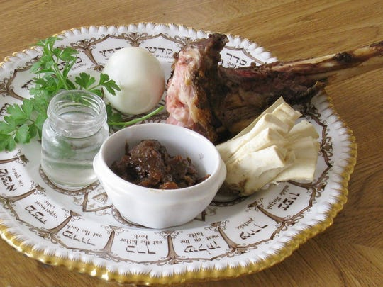 A Spode china ceremonial Passover plate on the Seder table is filled with symbolic foods that are explained and sampled as the Haggadah is read.