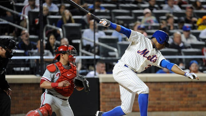 The Mets' Curtis Granderson, right, strikes out as Philadelphia's Carlos Ruiz looks on during the sixth inning on Saturday.