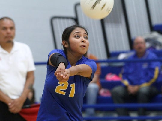 Bloomfield's Natasha Largo passes the ball against Miyamura on Tuesday at Bobcat Gym in Bloomfield.