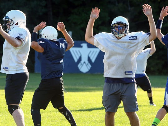 The Missisquoi Valley Thunderbirds do some jumping jacks during a recent practice in Swanton.