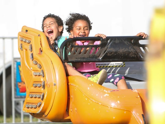 William Green, 8 and Adrianna Green, 6, of Burlington enjoy a spin on the Sizzler, their fourth consecutive ride at the 2016 Franklin County Field Days in Highgate. Field Days runs from Aug. 3-6.