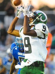 Parkside's Juwan Williams hauls in a touchdown pass against the North Caroline Bulldogs on Friday night in Ridgely.