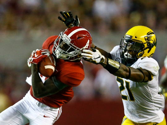 FILE - In this Oct. 13, 2018, file photo, Alabama wide receiver Jerry Jeudy (4) catches a pass over Missouri defensive back Christian Holmes (21) during the second half of an NCAA college football game, in Tuscaloosa, Ala. The sophomore receiver that made the preseason All-America team will be going up against fellow preseason All-America team member Greedy Williams, cornerback at LSU. No. 1 Alabama and No. 4 LSU play on Saturday, Nov. 3 in Baton Rouge, La.  (AP Photo/Butch Dill, File)