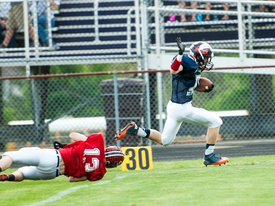 South receiver Jacob Fryer of Galion breaks free for