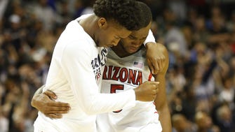 Arizona players react after losing to Xavier in the NCAA West Regional at SAP Center in San Jose, Calif. March 23, 2017. Arizona lost 73-71. (Via OlyDrop)