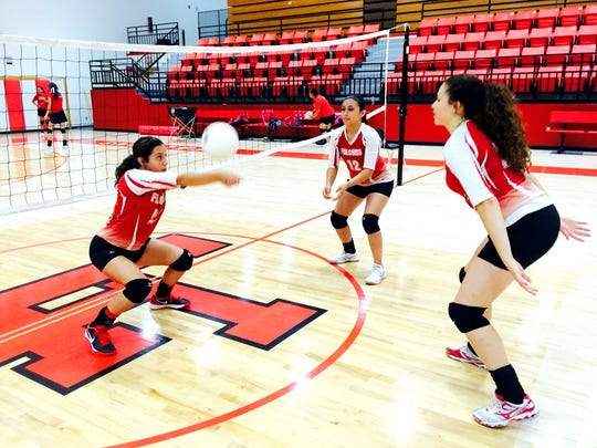 Loving looks to play faster volleyball in 2016. Alyssa Carrasco (22), Cassandra Calderon (12) and Jacqueline Pierce (20) are among the key returners.