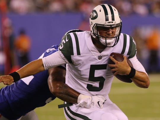 New York Jets quarterback Christian Hackenberg is tackled by New York Giants outside linebacker Jonathan Casillas in the second quarter.