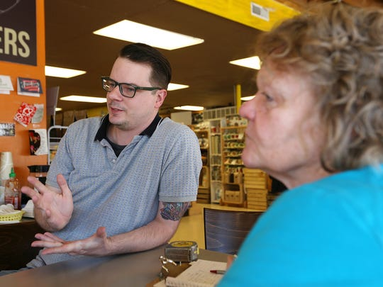 Indy Food Co-op board member Clark Giles and President Joni Albright talk about plans for Pogue's Run Grocer on East 10th Street.