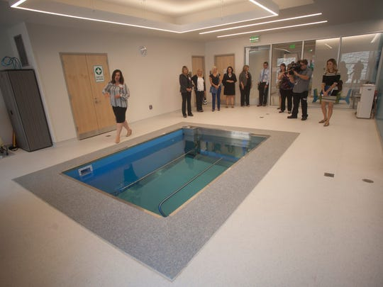 The heated pool features a moveable floor that can