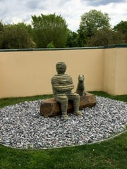 Boaz Vaadia's 'Asa with Dog' is a 2000 bronze, boulder,