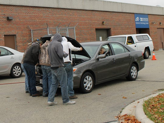 Plymouth High School students perform free vehicle inspections Oct. 27 at the school.