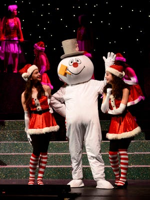 """Members of the Pensacola Children's Chorus perform during the 2015 production of """"Christmas on the Coast"""" at the Saenger Theatre. This year's concerts are set for Dec. 9-11/"""